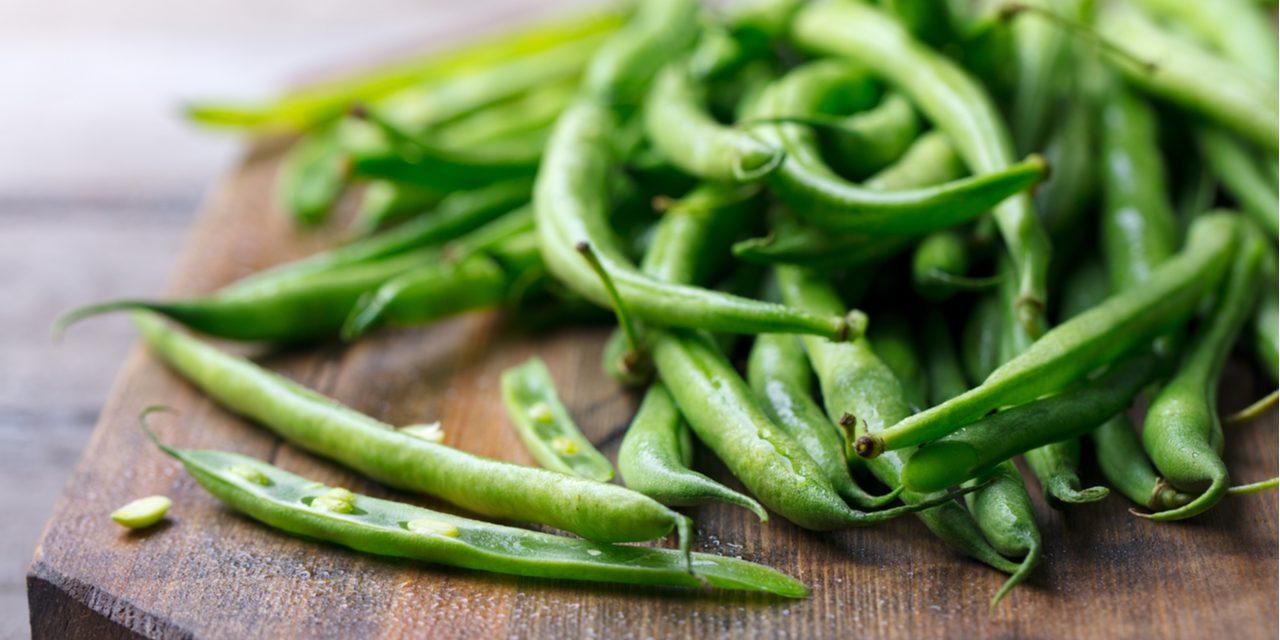 Hoe hou je groene boontjes mooi groen bij het koken?